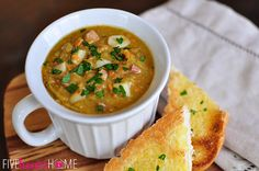 Slow Cooker Split Pea Soup ~ your crock pot does all the work for this warm and comforting soup, made hearty (but not heavy) by the addition of diced ham, potatoes, and carrots   {Five Heart Home}