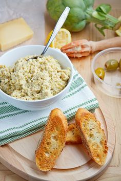 Artichoke and Green Olive Tapenade with Asiago  A chunky artichoke and olive tapenade with asiago that is packed full of flavour. Enjoy it for dipping or use it as a condiment on crostini or in sandwiches.
