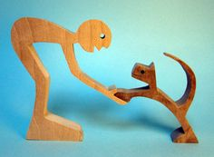 sculpture wood scalloped a man and his cat