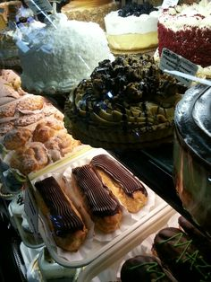 A glimpse into our bakery counter. Eclairs, cakes, pies and so much more.