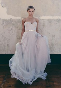 Oh man, this is THE BEST wedding dress. A flowing slightly lavender hued wedding gown. Gold belt just rubs in how freakin gorgeous it is.