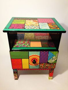 Colourful Patchwork style bedside table great for ethnic ,boho,gypsy or traditional folk,mexican home interior decor must make these for my girls rooms now they are growing up by upcycling the furniture with decoupage of vintage papers and varnish...also cool way to recover settee ,sofa and chairs