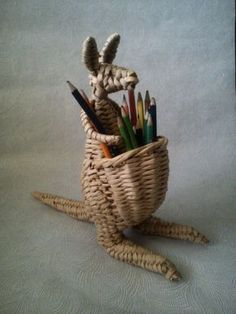 holding the pencils and pens.