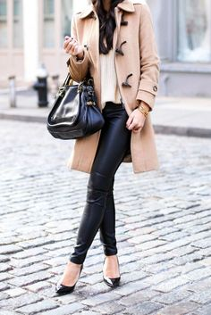 Kat Tanita of With Love From Kat wears a Burberry camel toggle coat, Ralph Lauren leather leggings, Jimmy Choo abel pumps, and a Chloe paraty bag in Soho.