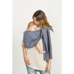Slings and carriers often create a bit of a learning curve in parents, so here's a simple how-to for newborn carrying in a ring sling carrier.