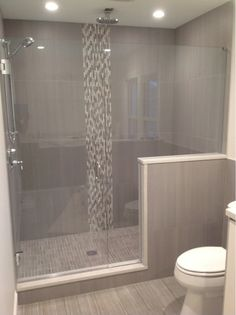 Many share the opinion the the vertical accent makes the space appear larger or longer. Also, notice the warmth the texture of the tile outside the shower brings. Alluring Glass, Inc provides frameless shower enclosures in Dayton and the Greater Cincinnati Ohio areas.