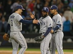 CHICAGO, IL - SEPTEMBER 27: (L-R) Evan Longoria #3, Fernando Rodney #56 and Carlos Pena #23 of the Tampa Bay Rays celebrate a win over the Chicago White Sox at U.S. Cellular Field on September 27, 2012 in Chicago, Illinois. The Rays defeated the White Sox 3-2. (Photo by Jonathan Daniel/Getty Images)