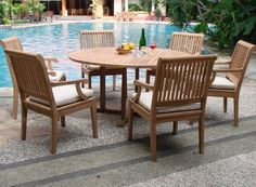 """New 7 Pc Luxurious Grade-A Teak Dining Set - 60"""" Round Table And 6 Arm Chairs [Model:SK1] by WholesaleTeak. $1429.99. Teak wood is an extremely dense course grained hardwood and is widely known for its durability.. 60"""" Round Table and includes umbrella hole in the center of table.. Table Dimension: 60"""" Round Table, 30.5"""" H. Sunbrella Seat Cushions for all chairs not included but available for extra Cost $295+Shipping $15.. Chair Dimension: 21.5"""" Width x 23.5"""" Depth x 35-1/..."""
