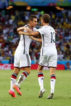Ghana Ties Germany 2-2 Tie In World Cup Thriller, Continues To Do U.S. No Favors Miroslav Klose of Germany celebrates with Thomas Mueller scoring his team's second goal during the 2014 FIFA World Cup Brazil Group G match between Germany and Ghana at Castelao on June 21, 2014 in Fortaleza, Brazil. (Photo by Martin Rose/Getty Images)