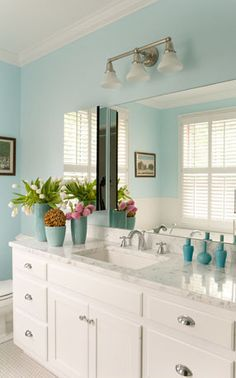 Aqua Love...great wall color an accents contrast with the crisp white vanity, carrara marble top and shiny chrome/nickel hardware.
