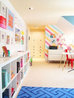 colorful office storage under long window with IKEA EXPEDIT for photoalbums and magazine file folders? b.