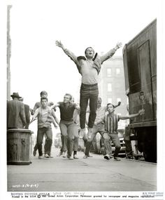 Russ Tamblyn (jumping), Tony Mordente, David Winters, David Bean and other dancers in West Side Story.