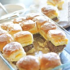 This recipe for sausage, egg, and cheese breakfast sliders is so simple to make, but the syrup glaze makes them over the top delicious. Anyone who loves the sweet and salty combo will adore this b…