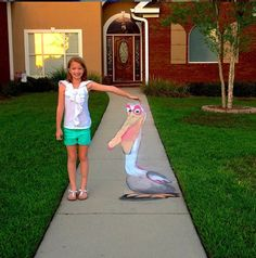 Can you believe this pelican (Nigel from Finding Nemo) is drawn with sidewalk chalk on the ground? He looks 3D!