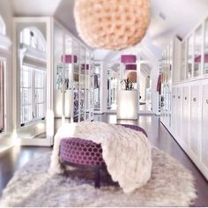 Plush luxury closet with mirrors