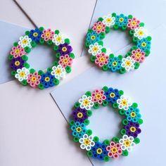 Flower wreaths hama beads by kolossaltpyssligt - Pattern: https://de.pinterest.com/pin/374291419014133811/