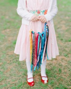 The flower girls carried colorful ribbon wreaths down the aisle, instead of baskets with petals.