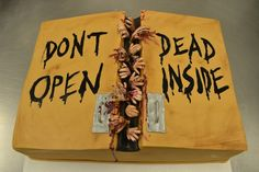 """""""Don't Open Dead Inside"""" Walking Dead birthday cake complete with zombie hands and fake blood.  Awesome."""