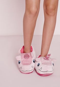 """These fluffy unicorn <a href=""""https://www.missguidedus.com/unicorn-slippers-pink#1"""" target=""""_blank"""">slippers</a>—$20.40"""