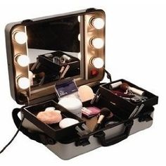 WANT!!! light up mirror makeup train case. I can do my makeup while I'm in my bed :)