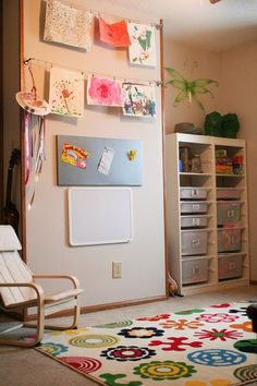 something like this on that little wall - a place for S's artwork to hang (and easily change out), a magnetic board or chalkboard or something else she'd use and love.