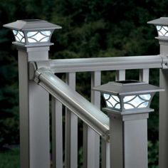 Solar Post Cap Light-Set of 2/$39.99. [If we go with these, they'd have to be painted.]