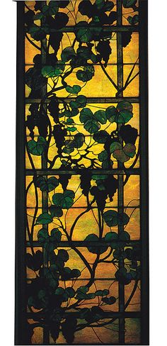 Bring the outdoors in....this lovely Tiffany stained window does just that !