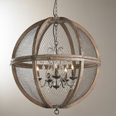 """Wire Sphere Crystal Chandelier - Large A charming crystal mini chandelier is nestled in a large solid wood sphere frame to create this unique country French chandelier. The distressed wood and wire combination bring the country French look together along with the bronze accents. A hinge on the sphere makes it easy to open for relamping. Hang over a large farm table or open foyer. 4 candelabra base bulbs required. Maximum 60 watts. (30""""Hx30""""W)"""