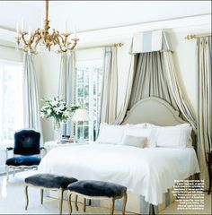 Pale blue and cream silk corona, bedskirt, curtains, deep blue velvet, chandelier - Dan Carithers in an Atlanta home