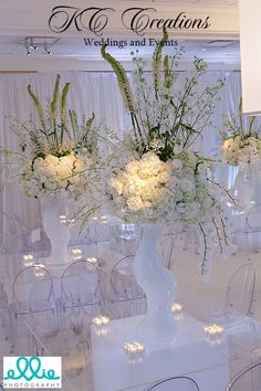 Unique centerpieces, unique wedding pedestals, one of a kind centerpiece stands, unusual white wedding centerpieces, Phaelanopsis orchids. white Holland flowers, paper flower wall, tent chandelier, lounge furniture, white dance floor, custom made oversized chandelier shade, Modern contemporary chic white wedding event space transformation at Alpine Country Club, NJ. Event design KC Creations Events. www.kccreationsevents.com