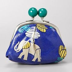 I fell in LOVE with this baby elephant change purse from Fossil this weekend!