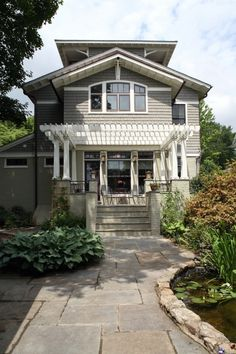 Essentially what I want to do with the exterior of the house.  Grey painted brick, white trim, black accents