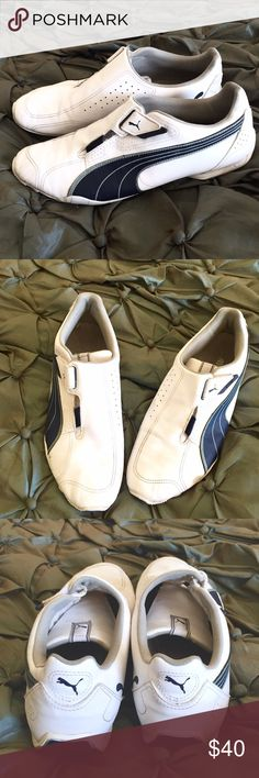 MENS PUMA ATHLETIC SHOES Great pair of Men's Puma Athletic shoes that have hardly been worn as they show very little wear. Color is white & navy blue leather outside in men's size 11 1/2. Puma Shoes Athletic Shoes
