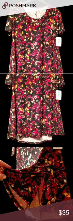 LuLaRoe floral top woman's size medium NWT Black and red floral LuLaRoe top with yellow accent. Super soft and comfy! Never worn, new with tags! LuLaRoe Tops Tees - Short Sleeve