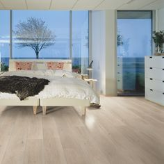 North Cape Oak is an elegant white floor offering that distinctive softwood feeling. As part of our Pergo Sensation collection with AquaSafe technology, it is virtually indistinguishable from real wood and offers exceptional water resistance. White Oak Laminate Flooring, Pergo Laminate, Types Of Wood Flooring, Solid Wood Flooring, Cork Wood, Italian Tiles, Tile Manufacturers, Plank, New England