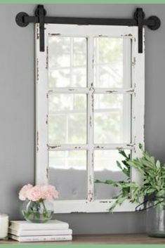 What a unique twist on an old farmhouse window favorite. A mirrored window on barn like rails. I would love this in my home. Rustic Antique White Farmhouse Mirror. 18.25L x 1.25W x 32.75H in #ad #homedecor #walldecor #farmhouse #rustichomedecor