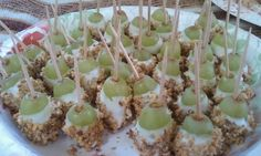 """Caramel Apple Bites""-Green grapes dipped in candy coating and rolled in nuts.  Add a toothpick for easy finger food that tastes EXACTLY like a caramel apple!  DELICIOUS!  (Via Muang)"