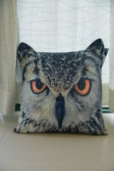 This owl cushion is basically the soft furnishing equivalent of a menacing whisper: YOU'RE ALWAYS BEING WATCHED.
