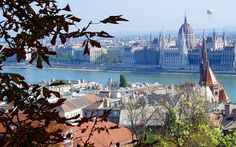 A perfect view of Budapest, Hungary: the historic and monumental Parliament building flanked by the Danube River.