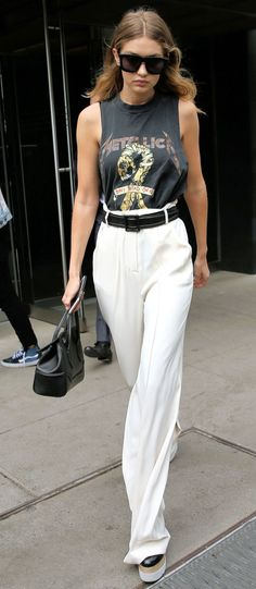 Gigi Hadid mixes tailored pants with a Metallica tee for a remix on edgy style.