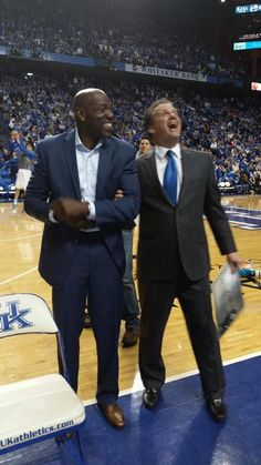 Calipari with Delk as he showed him his New Jersey in the rafters