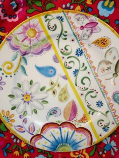Beautiful colored flowers an patterns on porcelain plate