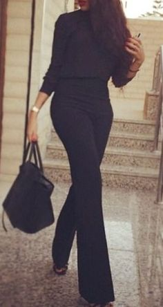 all black outfit. flared trousers.