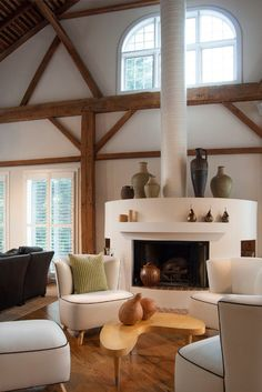 farmhouse living room : a highlight of the main floor is the cylindrical fireplace in the formal living area. it is an alternative to conventional box-style fireplaces.