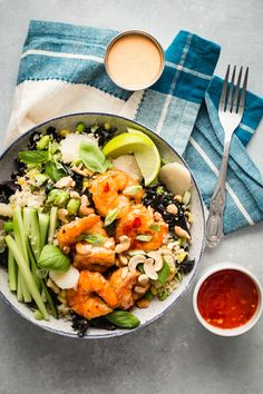 Giant Dynamite Shrimp tossed in a sweet and spicy chili sauce and plopped on top of the worlds tastiest quinoa and brown rice grain bowl!