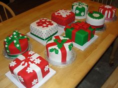 Mini Christmas Cakes These are 9 little 6 inch cakes I made for my Mom's work Christmas party. They used them as the table. Mini Christmas Cakes, Christmas Cake Designs, Christmas Cake Decorations, Christmas Minis, Christmas Sweets, Christmas Cooking, Holiday Cakes, Christmas Goodies, Xmas Cakes
