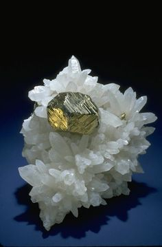 Pyrite with quartz - Mineral Gallery - Smithsonian Institution