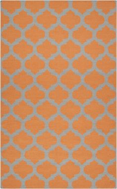 Surya's citrus-colored Frontier collection rugs are super hot this season.