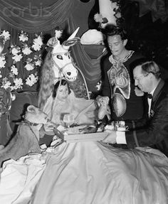 1941 Surrealist artist Salvador Dali designs and hosts a party held in the Bali Room of the Hotel Del Monte, Monterey, California. The event was titled Night in a Surrealist Forest and it was a fund raiser to help European artists displaced by the war.