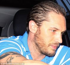 Gel-raising: Tom Hardy showed off an over-stylised barnet as he signed autographs in New York earlier today
